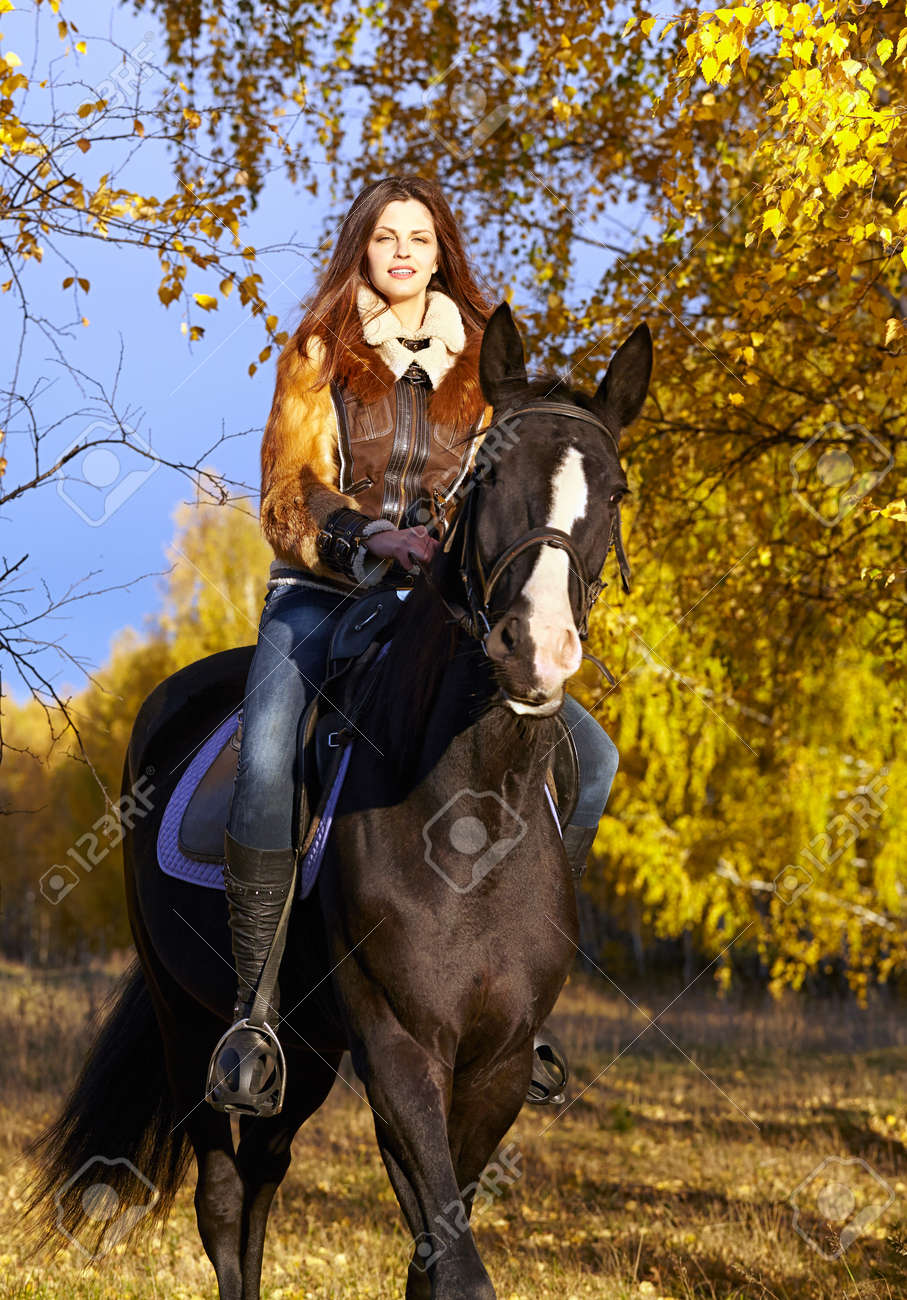 Portrait Of A Pretty Young Woman With A Black Horse Riding Autumn Stock Photo Picture And Royalty Free Image Image 17166158