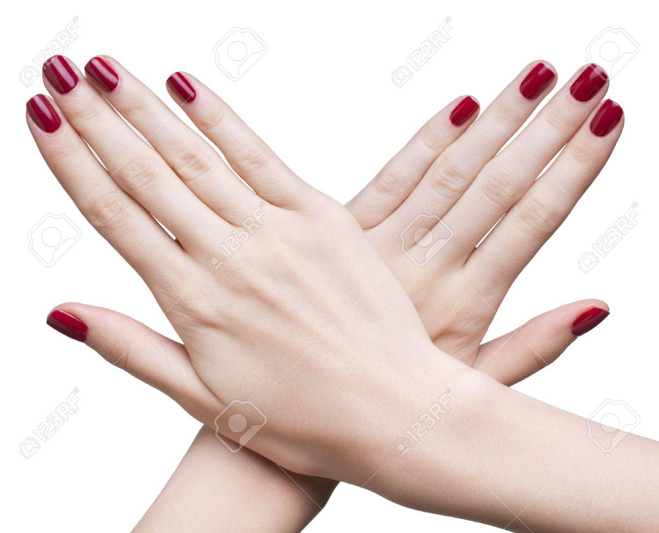 hands with woman's professional red nails manicure isolated on white Stock Photo - 17460676