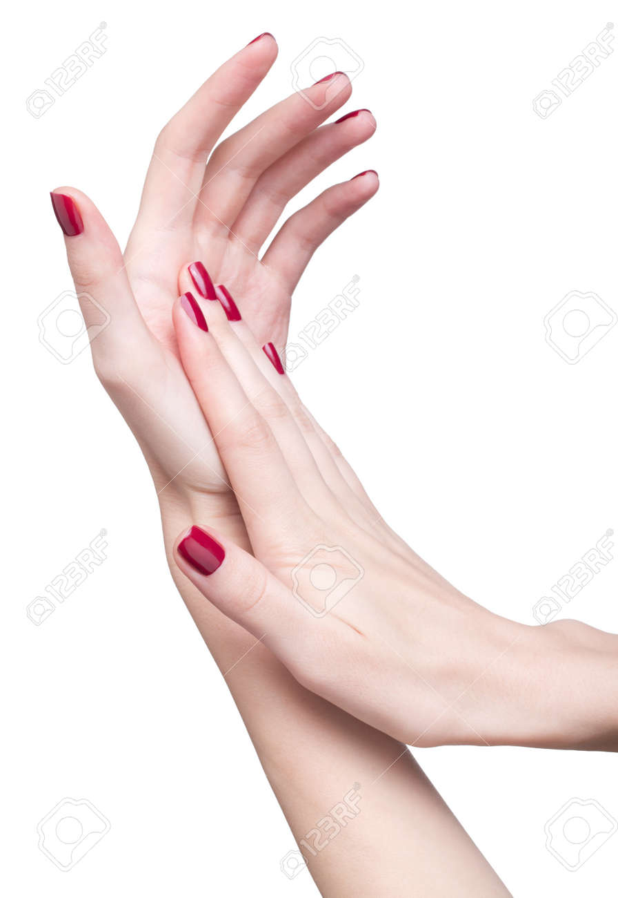 hands with woman's professional red nails manicure isolated on white Stock Photo - 17460654