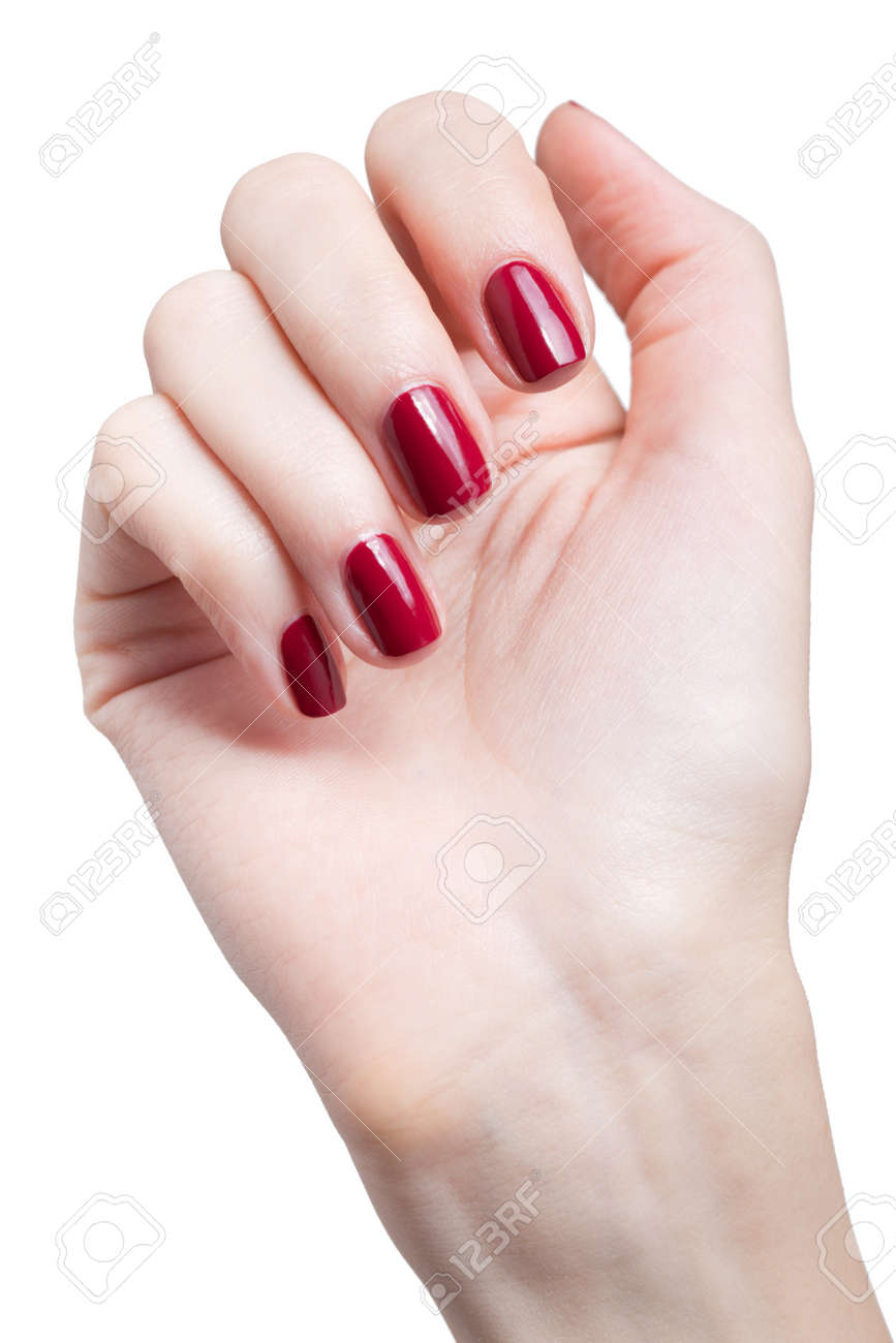 hands with woman's professional red nails manicure isolated on white Stock Photo - 17460679