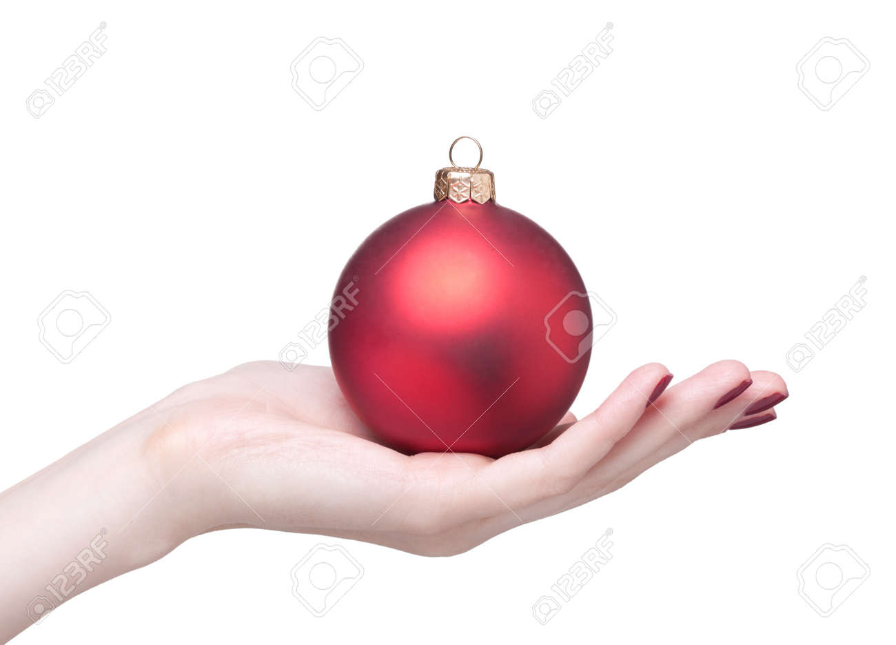 hands with red dull luster Christmas ball isolated on white Stock Photo - 17460628
