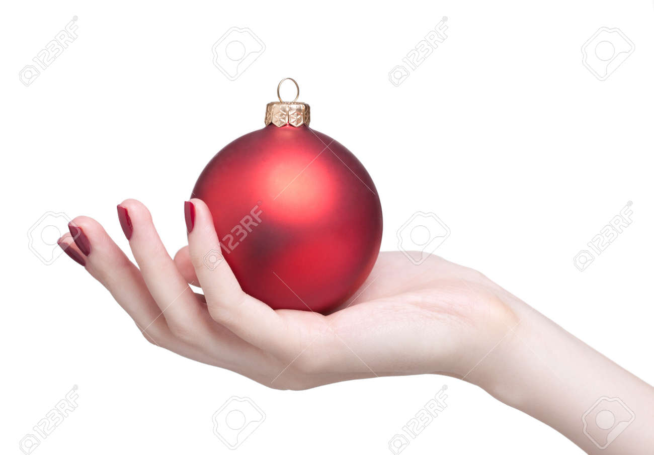 hands with red dull luster Christmas ball isolated on white Stock Photo - 17460634