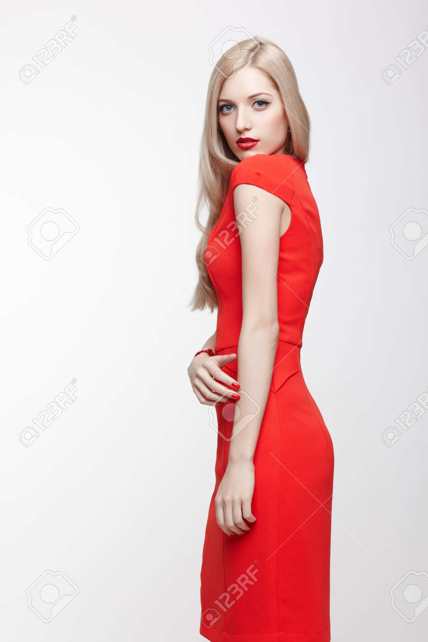 portrait of young slim beautiful blonde woman in red dress Stock Photo - 17566676