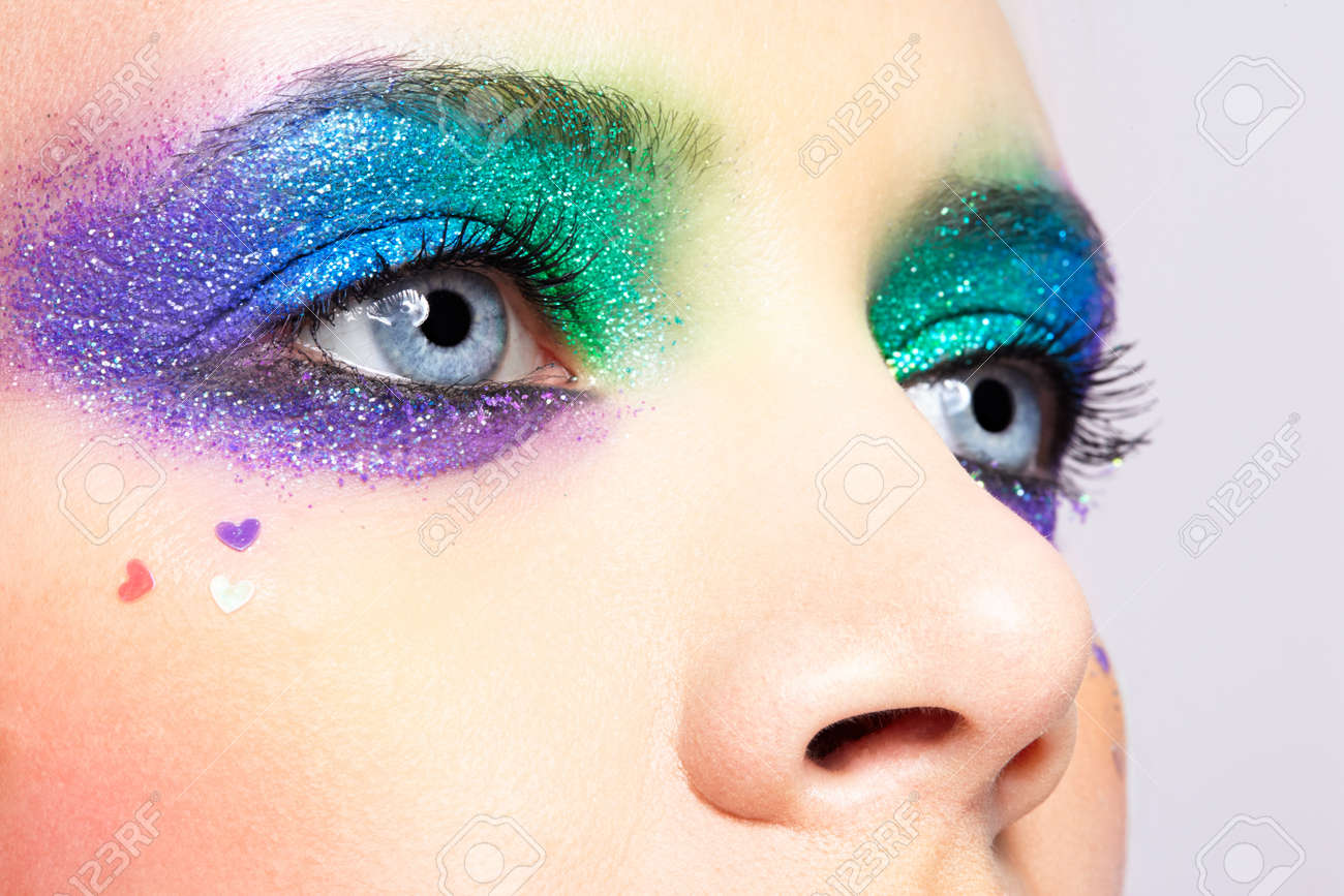 Closeup shot of shining holiday spangled female eye makeup - 28456911