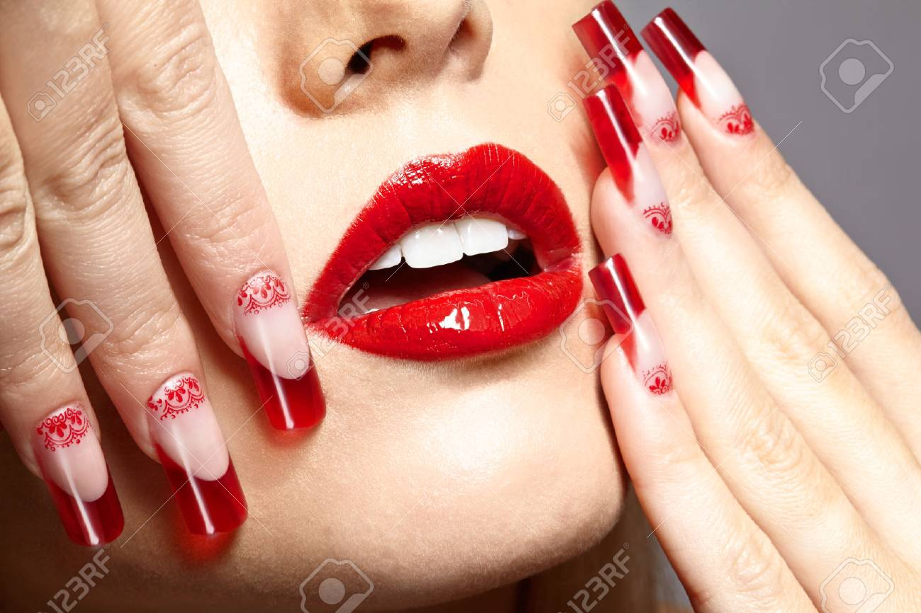 Fingers With Red French Acrylic Nails Manicure And Paiting Stock ...