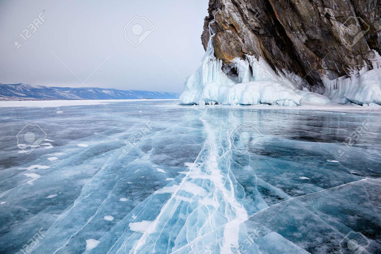 Rocks frozen into the ice of siberian Baikal Lake in winter - 31467456