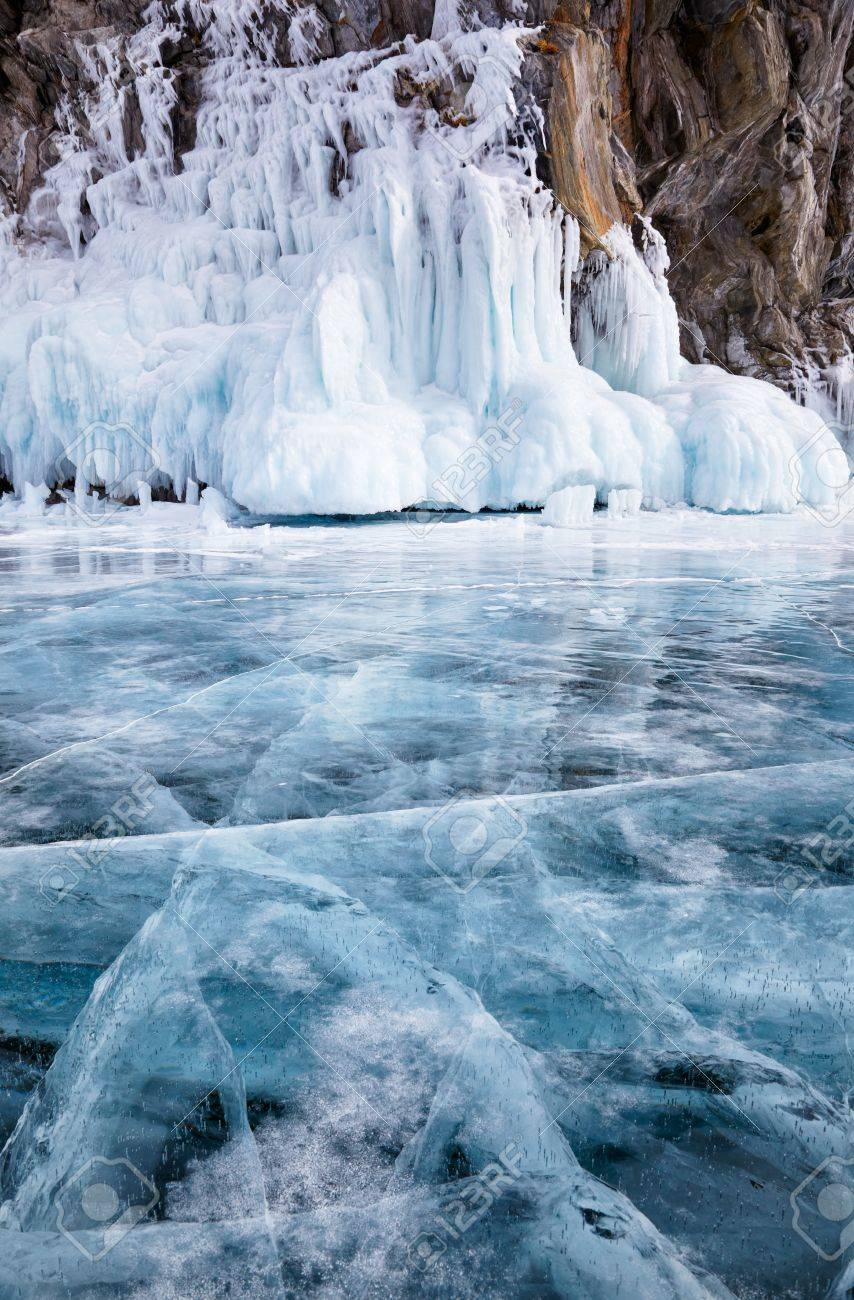 Rocks frozen into the ice of siberian Baikal Lake in winter - 31467465