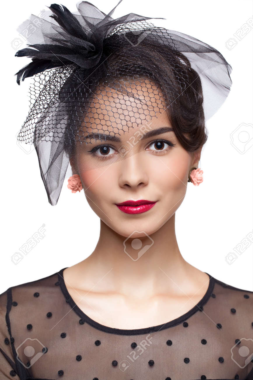 50071c96c Young woman in vintage dress and small female hat with veil isolated..