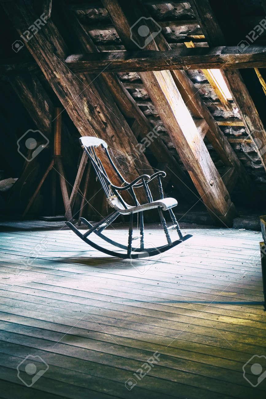 Vintage rocking chair on deserted old attic floor in Round Tower in Copenhagen, Denmark. - 32161658
