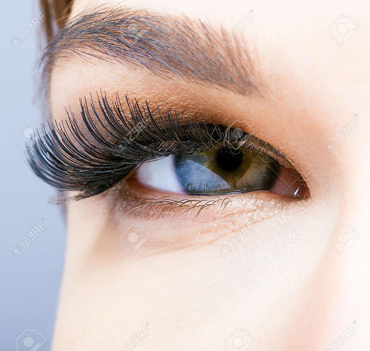 Female eye with long eyelashes closeup shot - 36611827