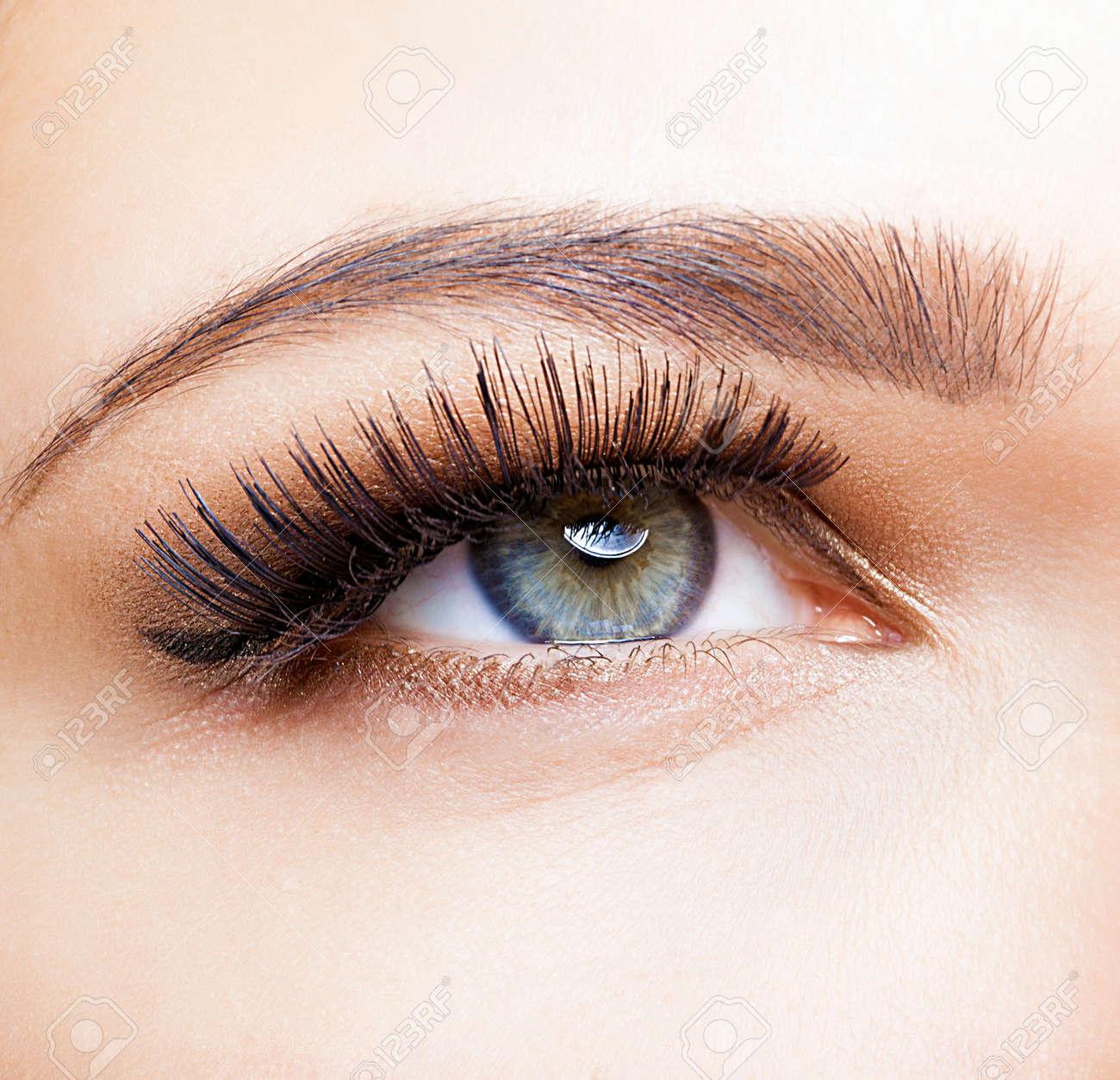Female eye with long eyelashes closeup shot - 36611831