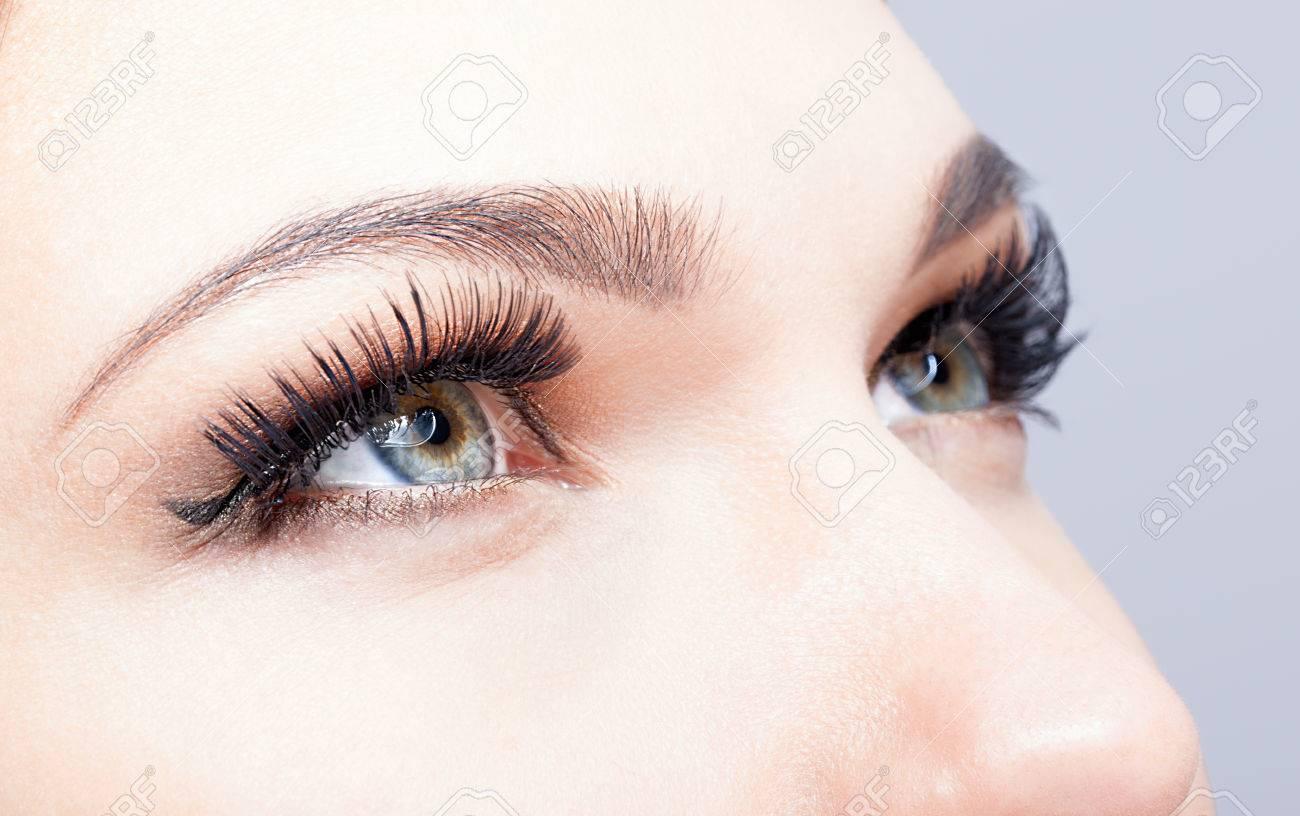 Female eye with long eyelashes closeup shot - 36611836