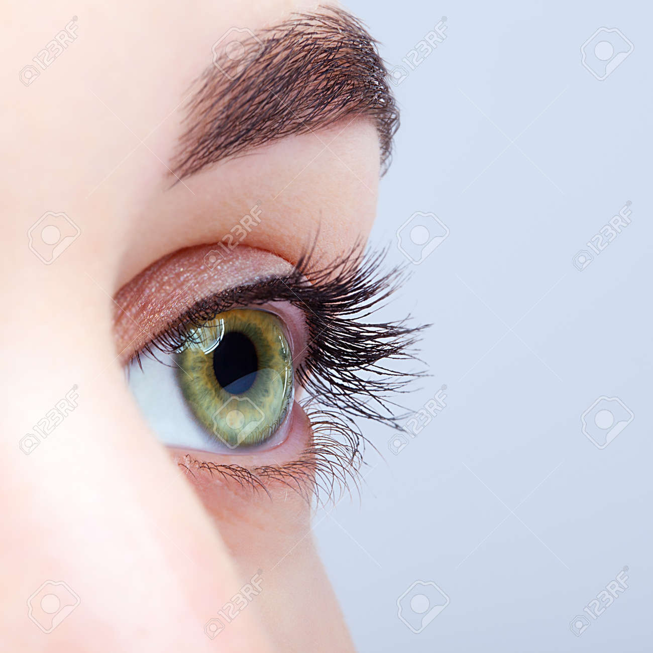 Closeup shot of female green pistachio colour eye with day makeup - 37028663