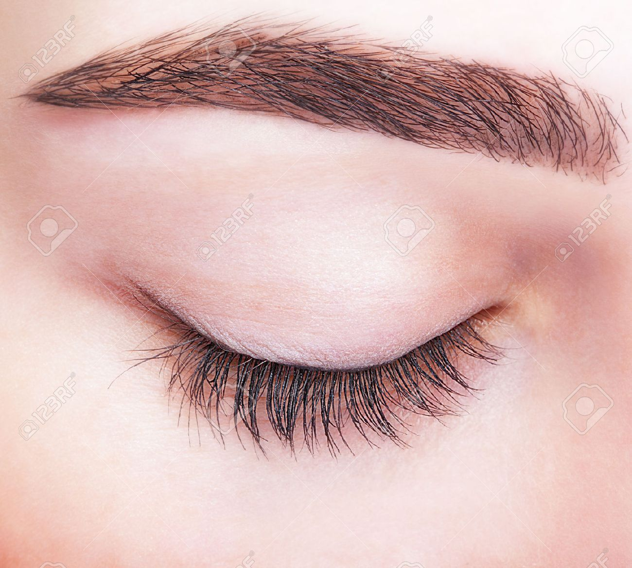 Closeup shot of female closed eye and brows with day makeup - 37028664