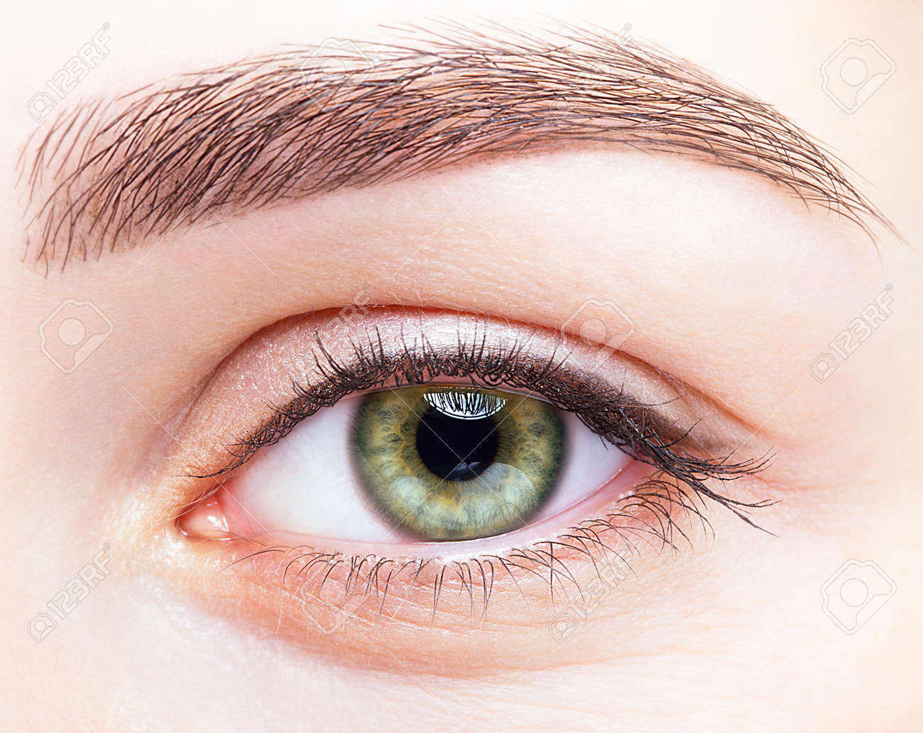 Closeup shot of female green pistachio colour smiling eye with day makeup - 37028667
