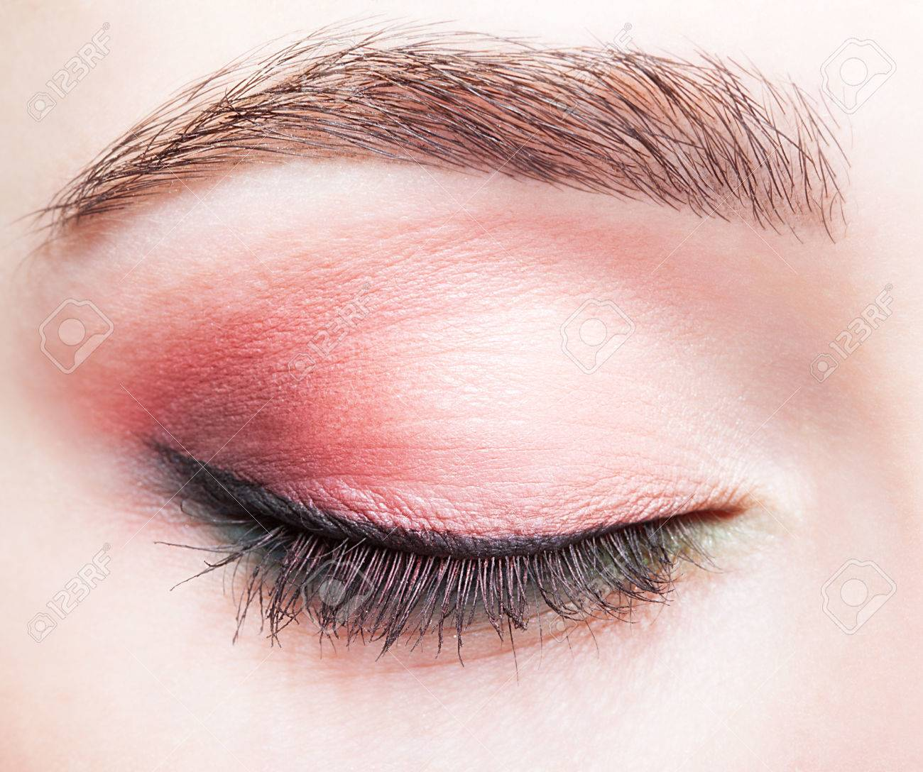 Closeup shot of female closed eye and brows with day makeup - 37028670