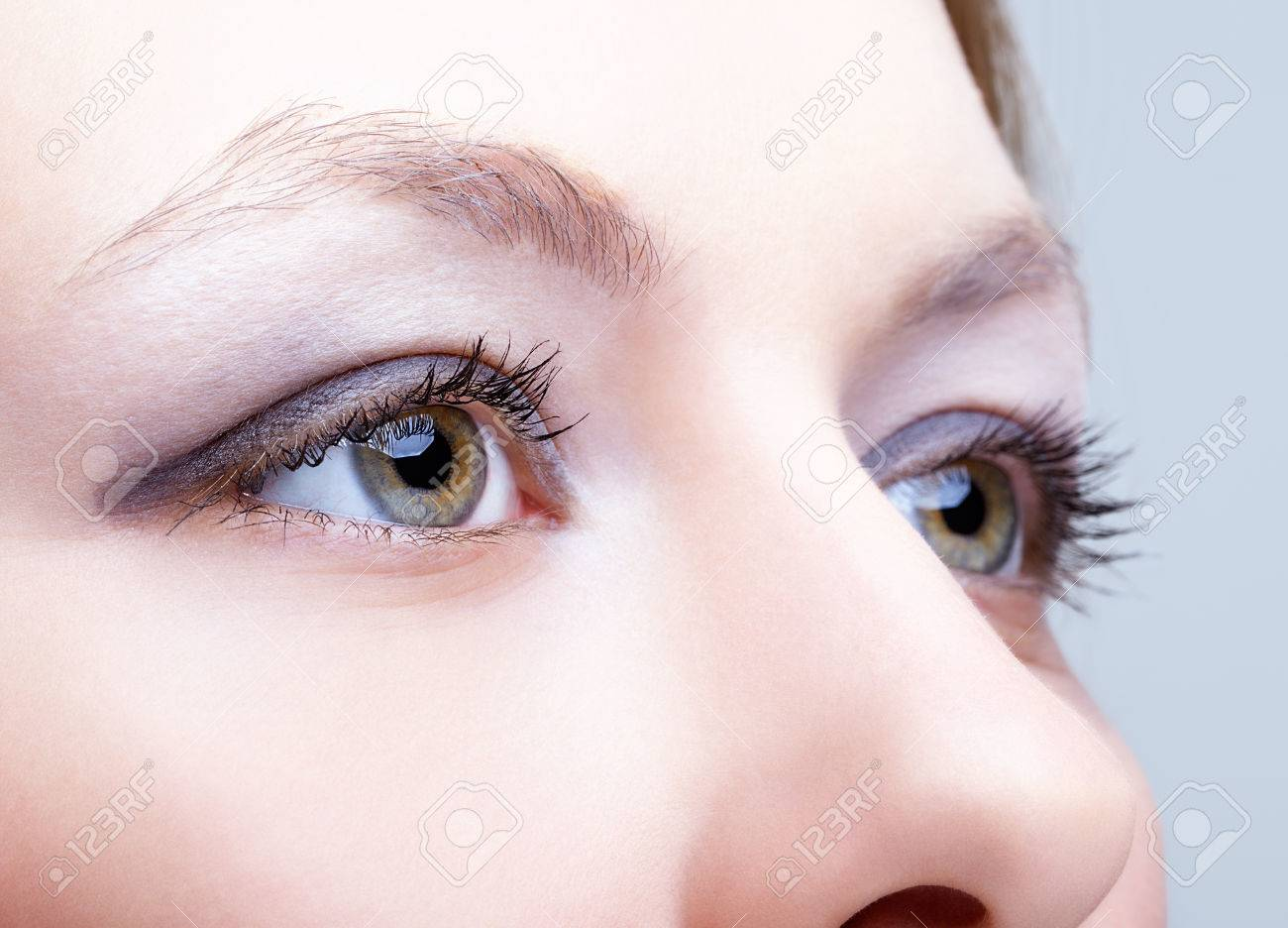Close-up shot of female face with eyes makeup - 43251143