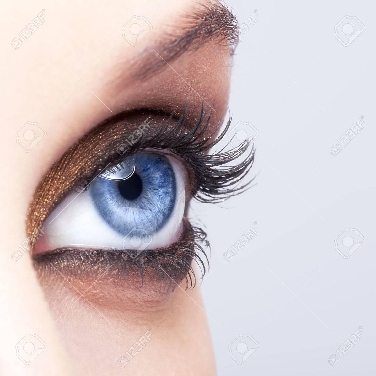 Close-up shot of female eye make-up in smoky eyes style - 43889263