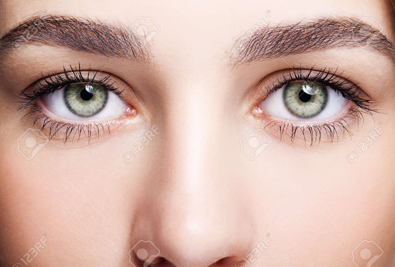 Closeup shot of female green pistachio colour eye with day makeup - 46391731