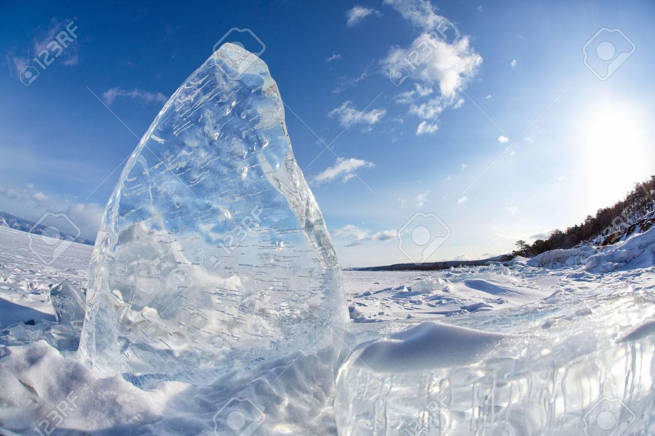 Ice floe and sun on winter Baikal lake - 47375900