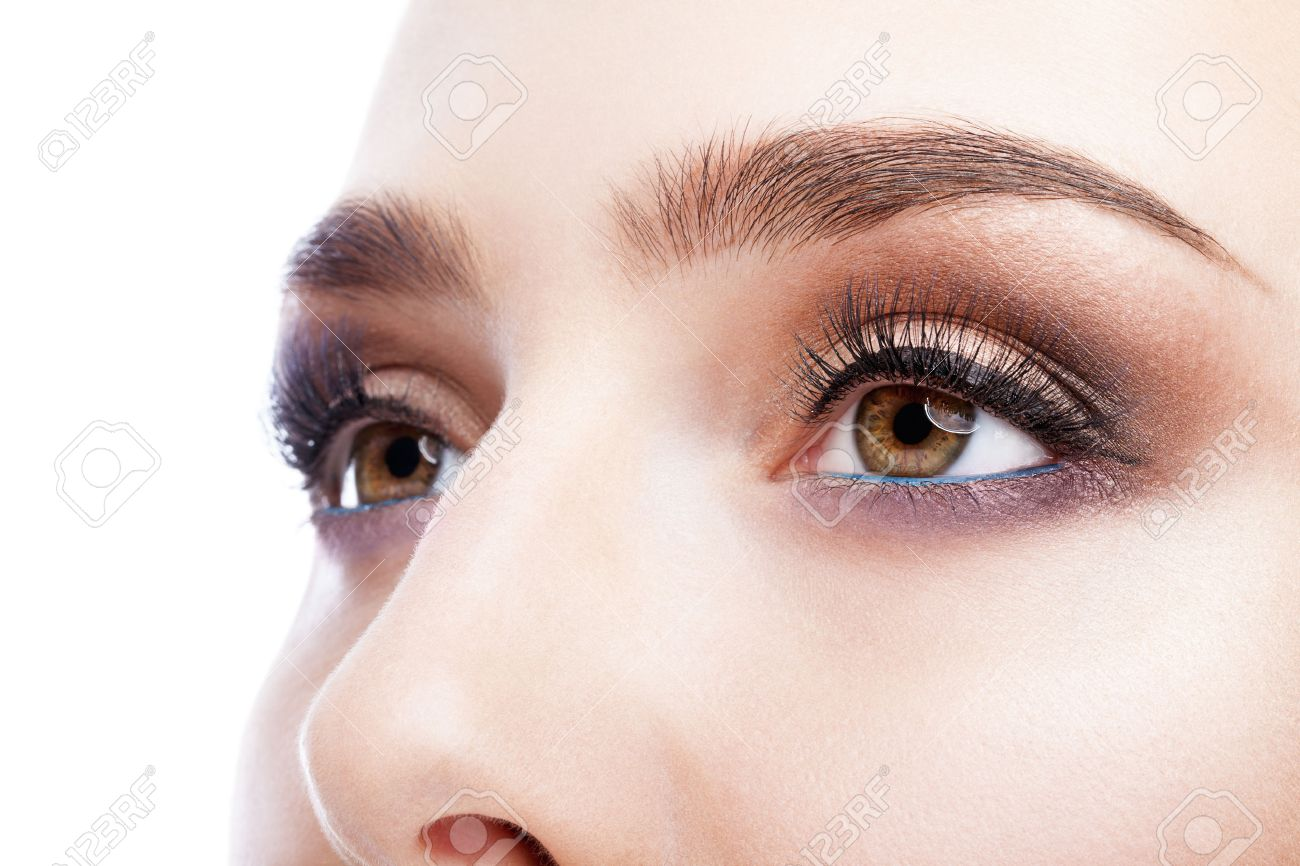 Closeup shot of female eye with day makeup in aqua Limpet Shell color eye shadows and Snorkel Blue colour liner - 50254997