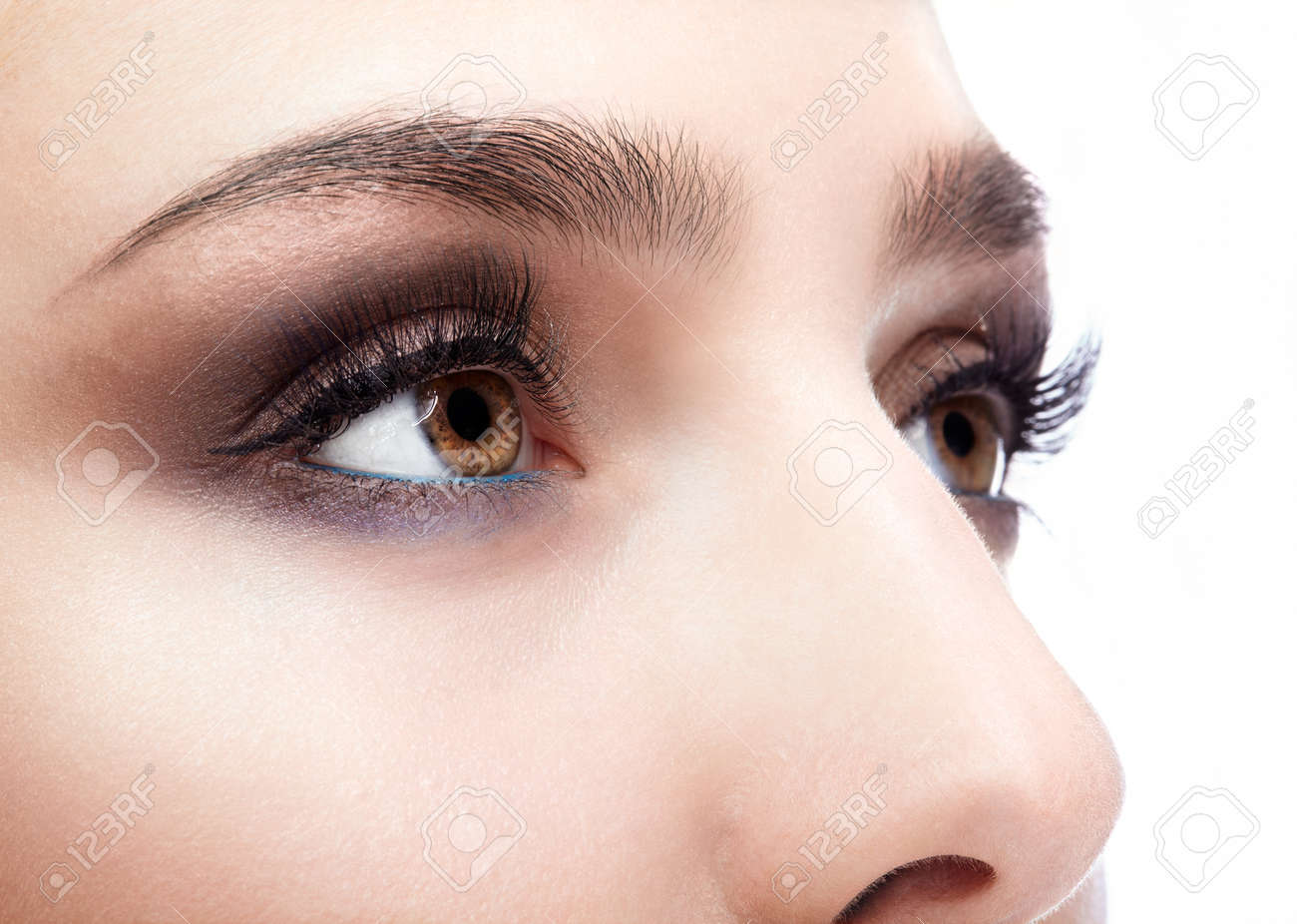 Closeup shot of female eye with day makeup in aqua Limpet Shell color eye shadows and Snorkel Blue colour liner - 50255047