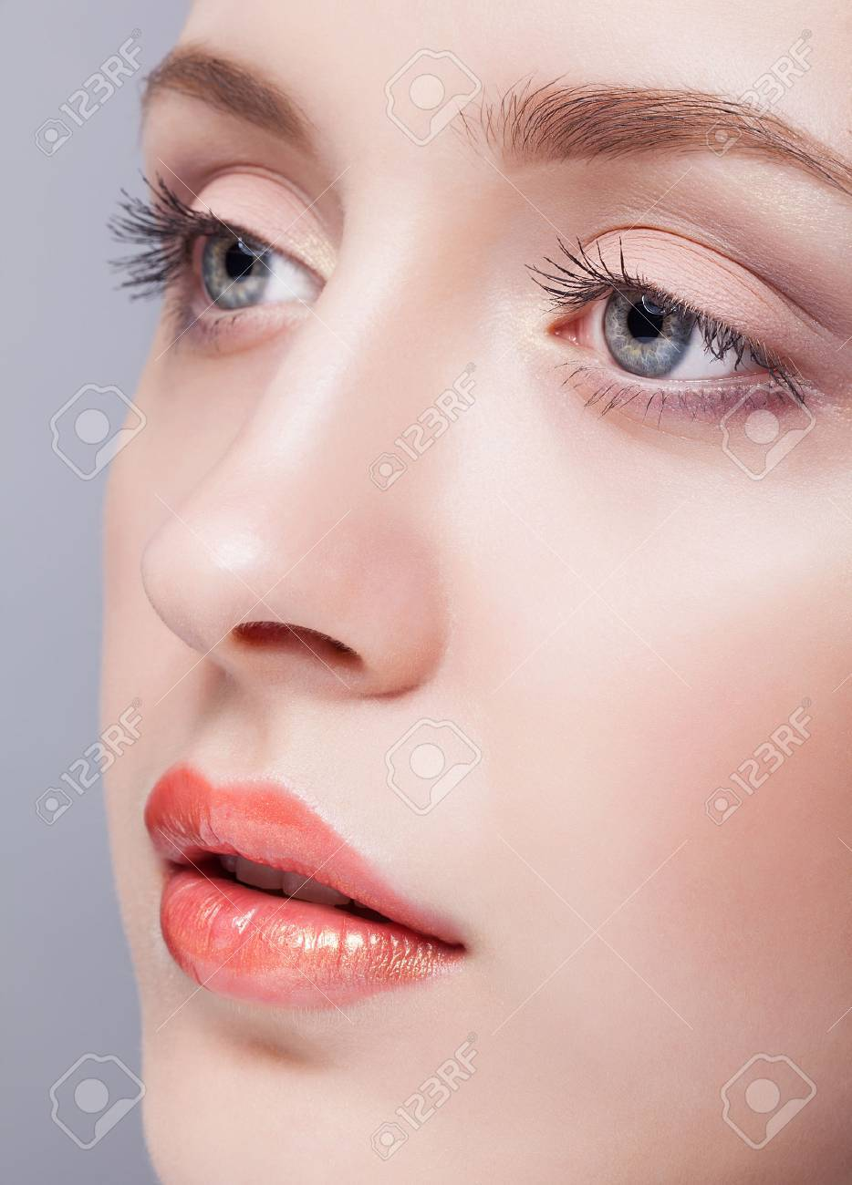 Closeup shot of female blue colour eyes with day makeup - 55841447