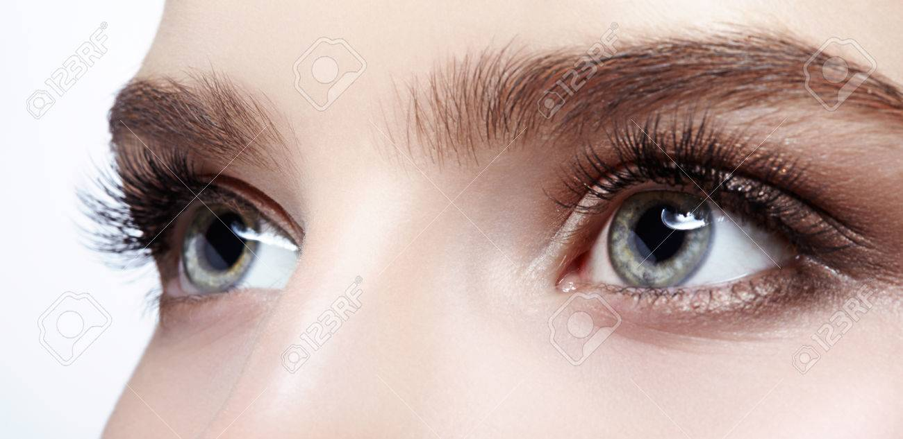 Closeup shot of female face with eye day makeup - 74803693