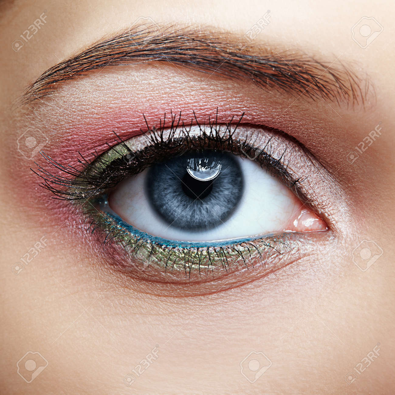 Closeup Macro Image Of Human Female Eye With Pink And Green Makeup