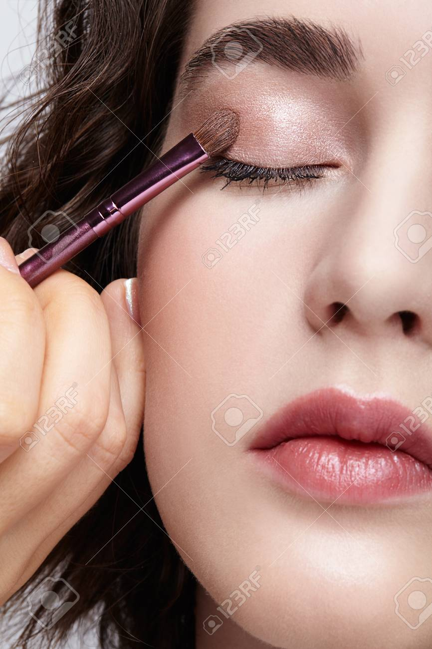 Make Up Artist Apply Beauty Makeup On The Eyelids On Face Of Stock Photo Picture And Royalty Free Image Image 107496402
