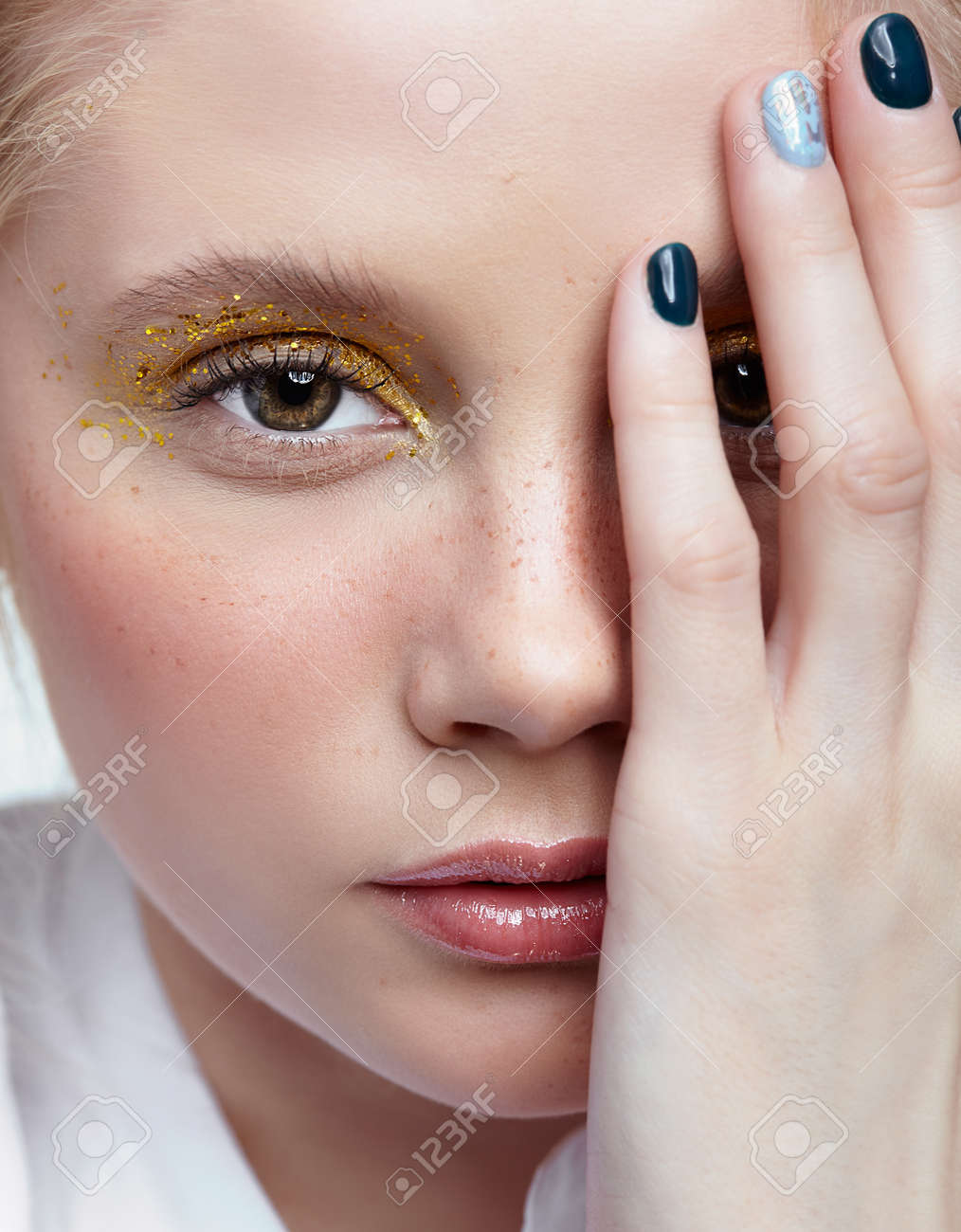 Closeup Shot Of Human Female Face Woman With Unusual Glitter Stock Photo Picture And Royalty Free Image Image 112465099