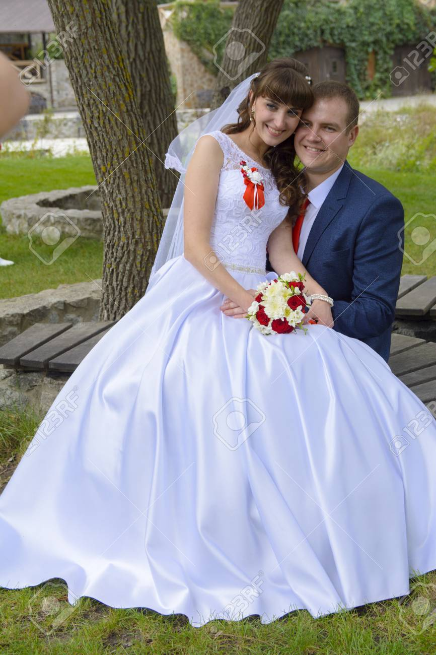 Beautiful And Happy Young Bride And Groom In Wedding Dress On ...
