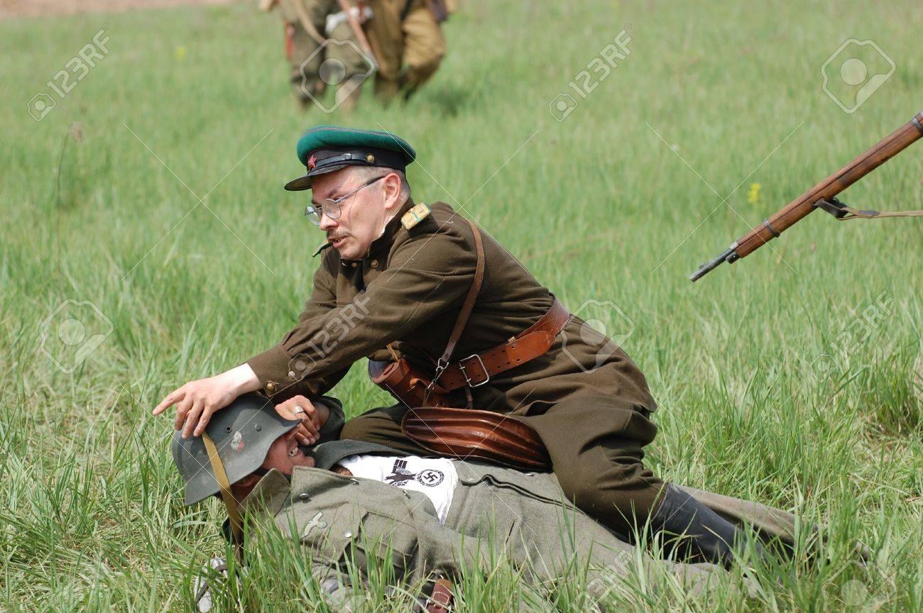 KIEV, UKRAINE - MAY 10 : Members of Red Star history club wear historical German&Soviet uniform during historical reenactment of 1945 WWII, May 10, 2010 in Kiev, Ukraine  Stock Photo - 7551316