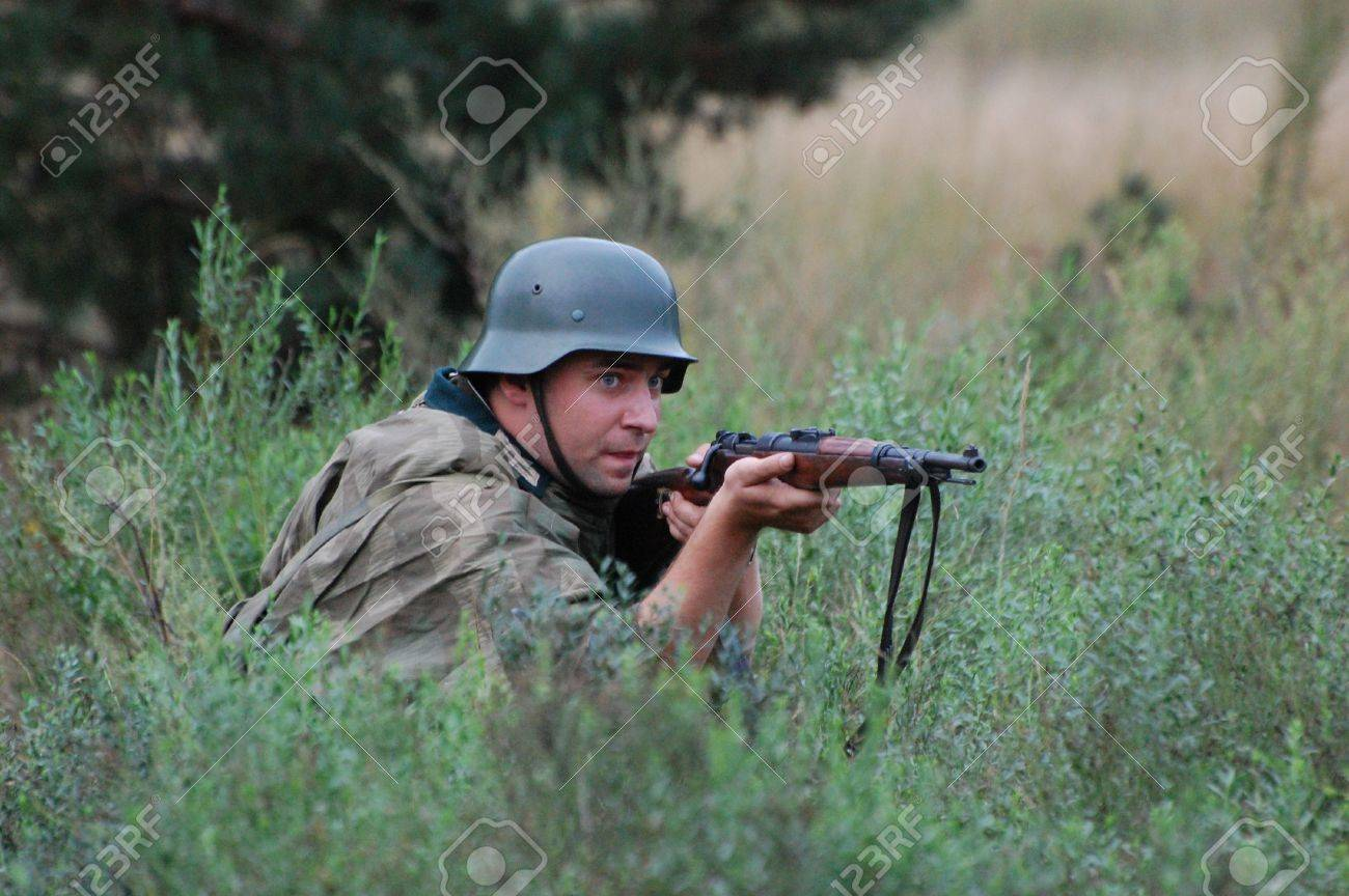 CHERNIGOW, UKRAINE - AUG 29: A member of Red Star military history club wears historical German uniform during historical reenactment of WWII, August 29, 2010 in Chernigow, Ukraine  Stock Photo - 7665916