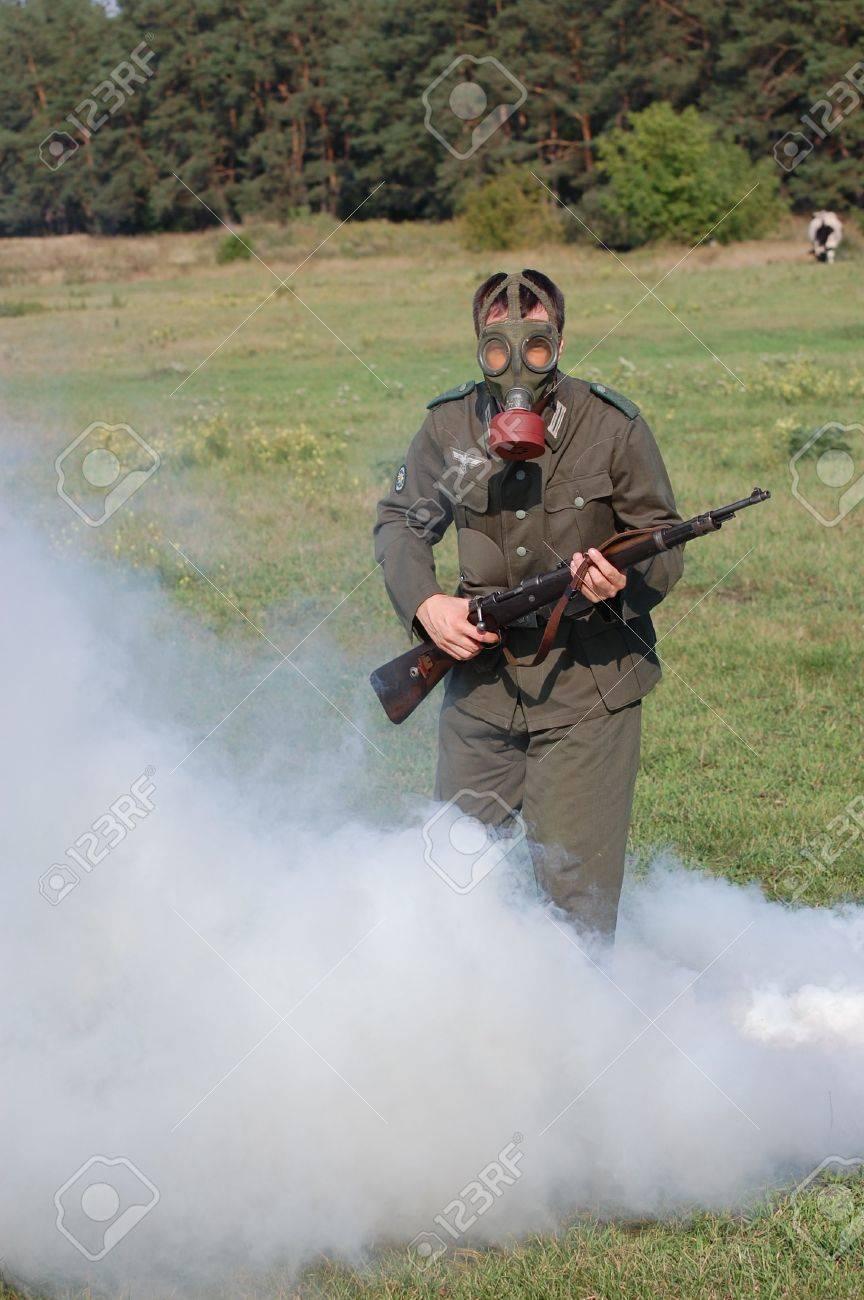 German soldier in gas mask. WW2 reenacting Stock Photo - 7810381