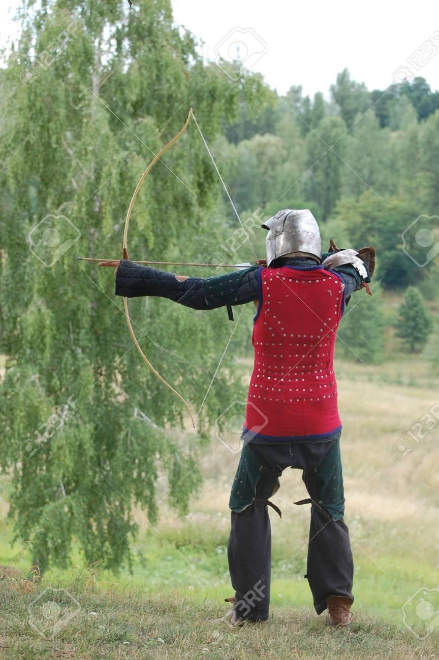 KIEV, UKRAINE - JULY 31: Member of history club Golden Capricorn wears medieval costume as he participates in historical festival and camp in memory of King Vladimir July 31, 2009 in Kiev, Ukraine Stock Photo - 8410152