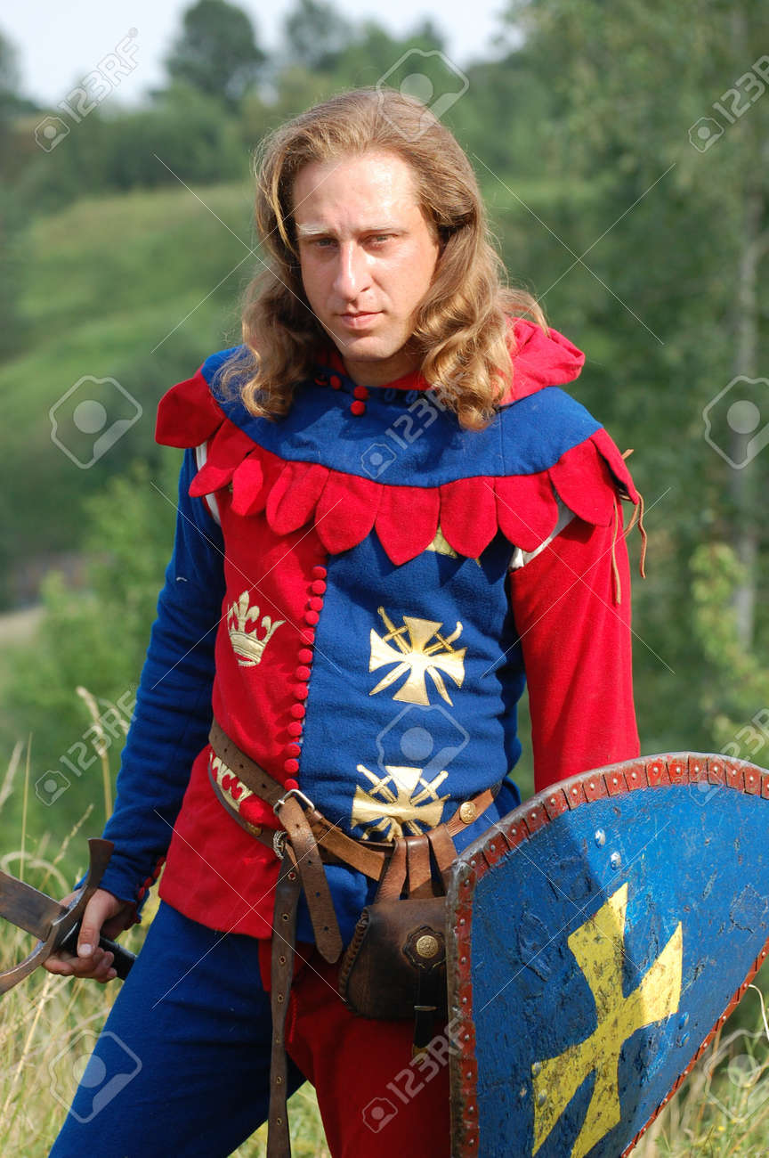 KIEV, UKRAINE - JULY 31: Member of history club Golden Capricorn wears medieval costume as he participates in historical festival and camp in memory of King Vladimir July 31, 2009 in Kiev, Ukraine.  Stock Photo - 8502083