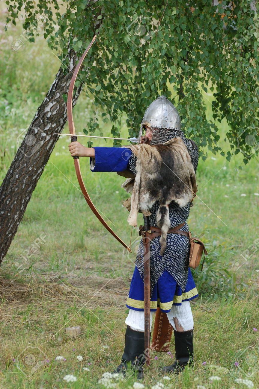KIEV, UKRAINE - JULY 31: Member of history club Golden Capricorn wears medieval costume as he participates in historical festival and camp in memory of King Vladimir July 31, 2009 in Kiev, Ukraine.  Stock Photo - 8502106