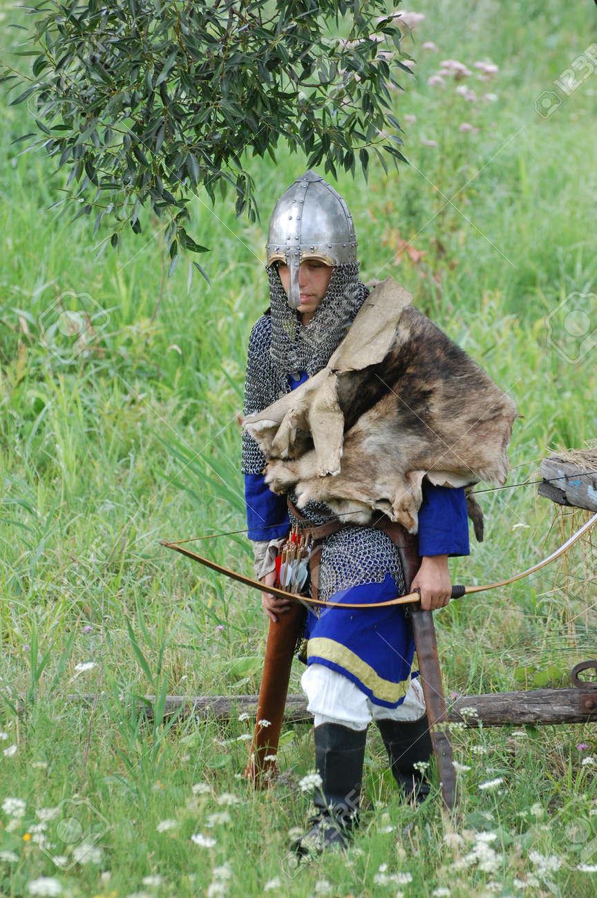 KIEV, UKRAINE - JULY 31: Member of history club Golden Capricorn wears medieval costume as he participates in historical festival and camp in memory of King Vladimir July 31, 2009 in Kiev, Ukraine.  Stock Photo - 8502107