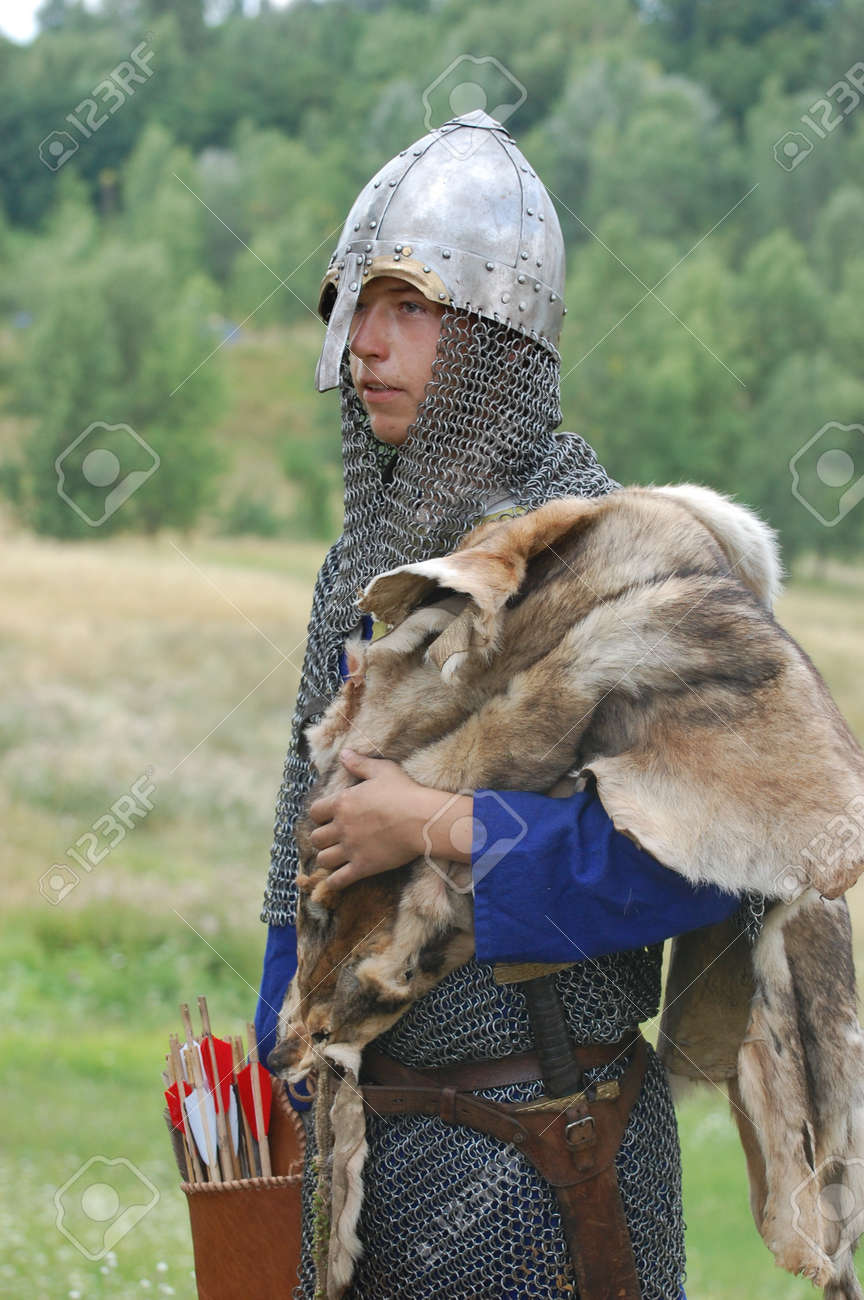 KIEV, UKRAINE - JULY 31: Member of history club Golden Capricorn wears medieval costume as he participates in historical festival and camp in memory King Vladimir July 31, 2009 in Kiev, Ukraine Stock Photo - 8707330