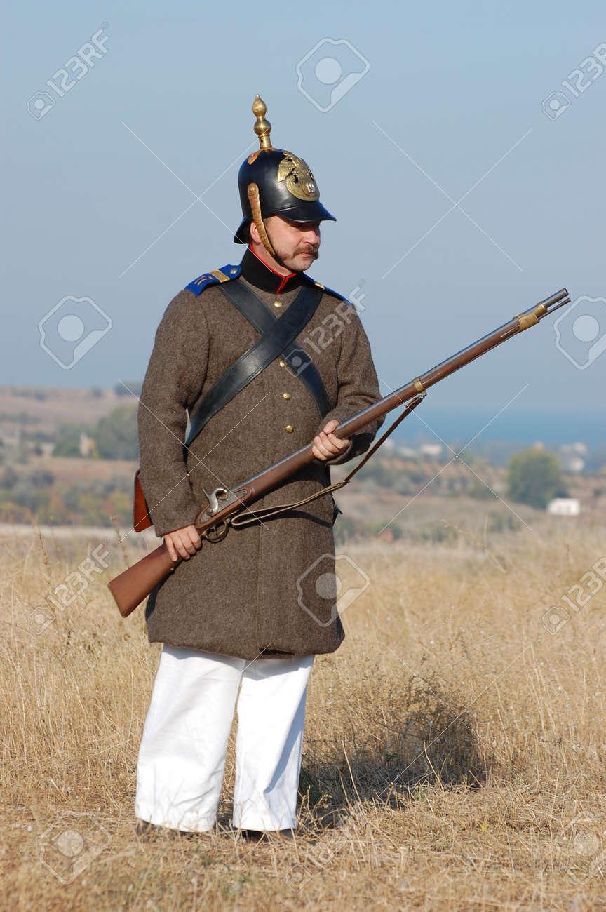 CRIMEA, UKRAINE - SEPTEMBER 26: Member of military history club ALMA wears Russian historical uniform during historical reenactment of Crimean War September 26, 2009 in Crimea, Ukraine  Stock Photo - 8739264