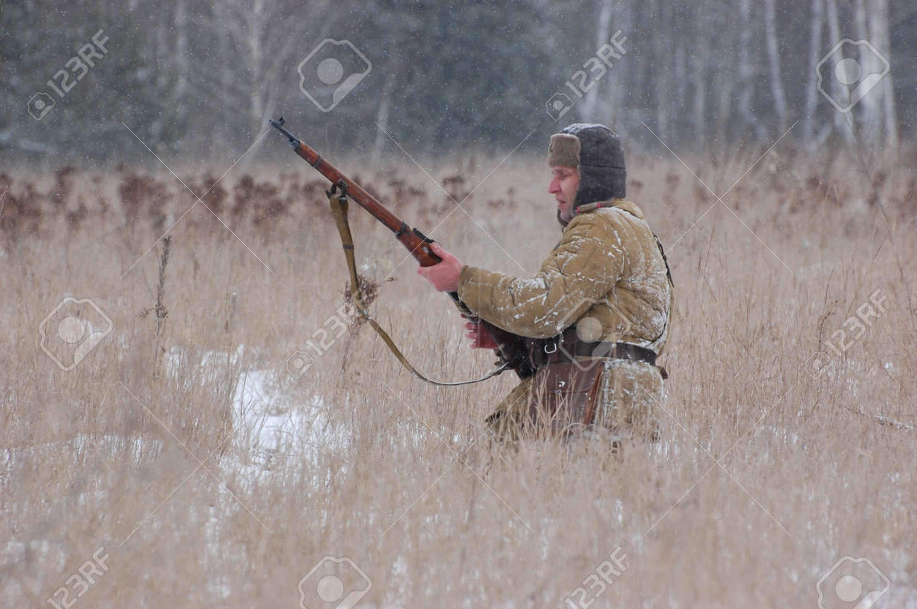 KIEV, UKRAINE - FEB 20: A member of military history club Red Star wears historical Soviet uniform during historical reenactment of WWII,February 20, 2011 in Kiev, Ukraine Stock Photo - 8995485