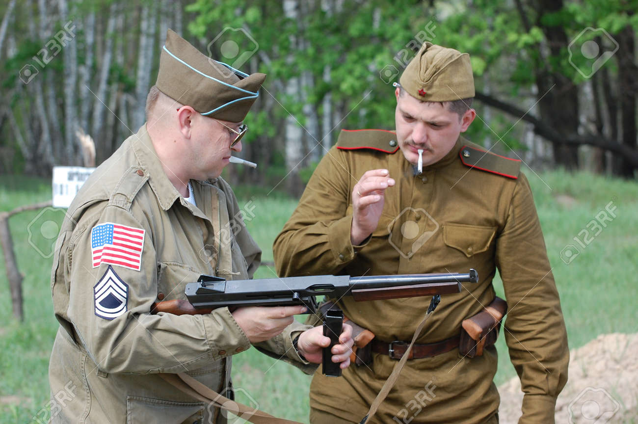 KIEV, UKRAINE - MAY 10 : members of Red Star history club wear historical American&Soviet uniforms during participation in 1945 WWII reenactment May 10, 2010 in Kiev, Ukraine  Stock Photo - 9271990
