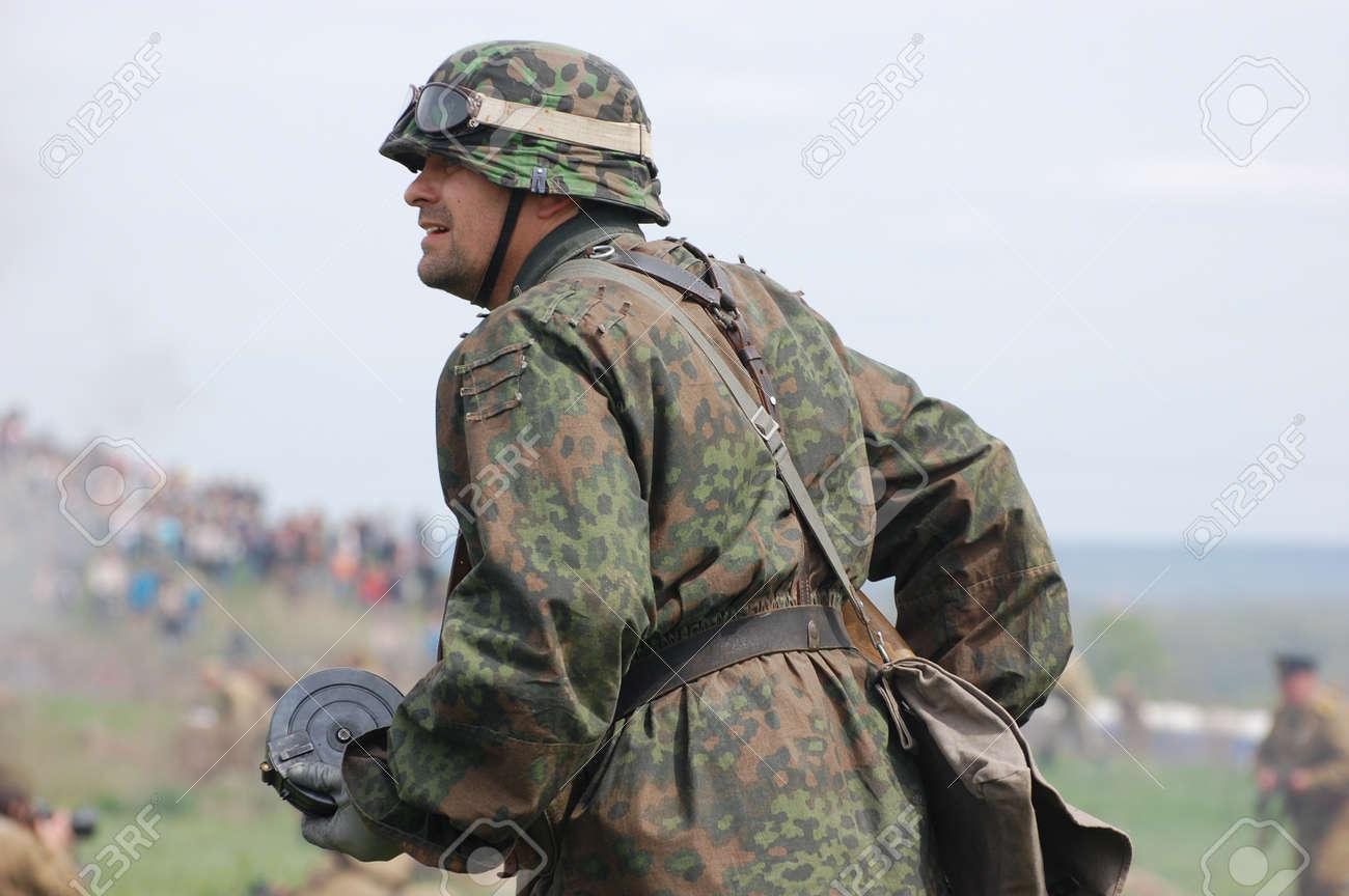 KIEV, UKRAINE - MAY 8 : Member of Red Star history club wears historical German uniform during historical reenactment of WWII on May 8, 2011 in Kiev, Ukraine  Stock Photo - 10006602