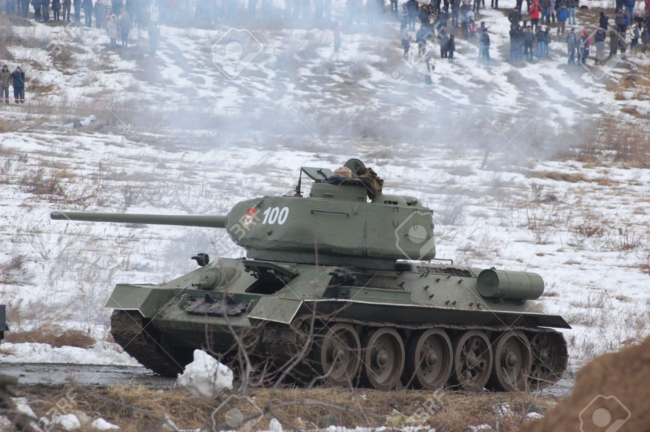 KIEV, UKRAINE -FEB 25: Old Russian tank T-34 during historical reenactment of WWII,Military history club Red Star. February 25, 2012 in Kiev, Ukraine  Stock Photo - 12444560