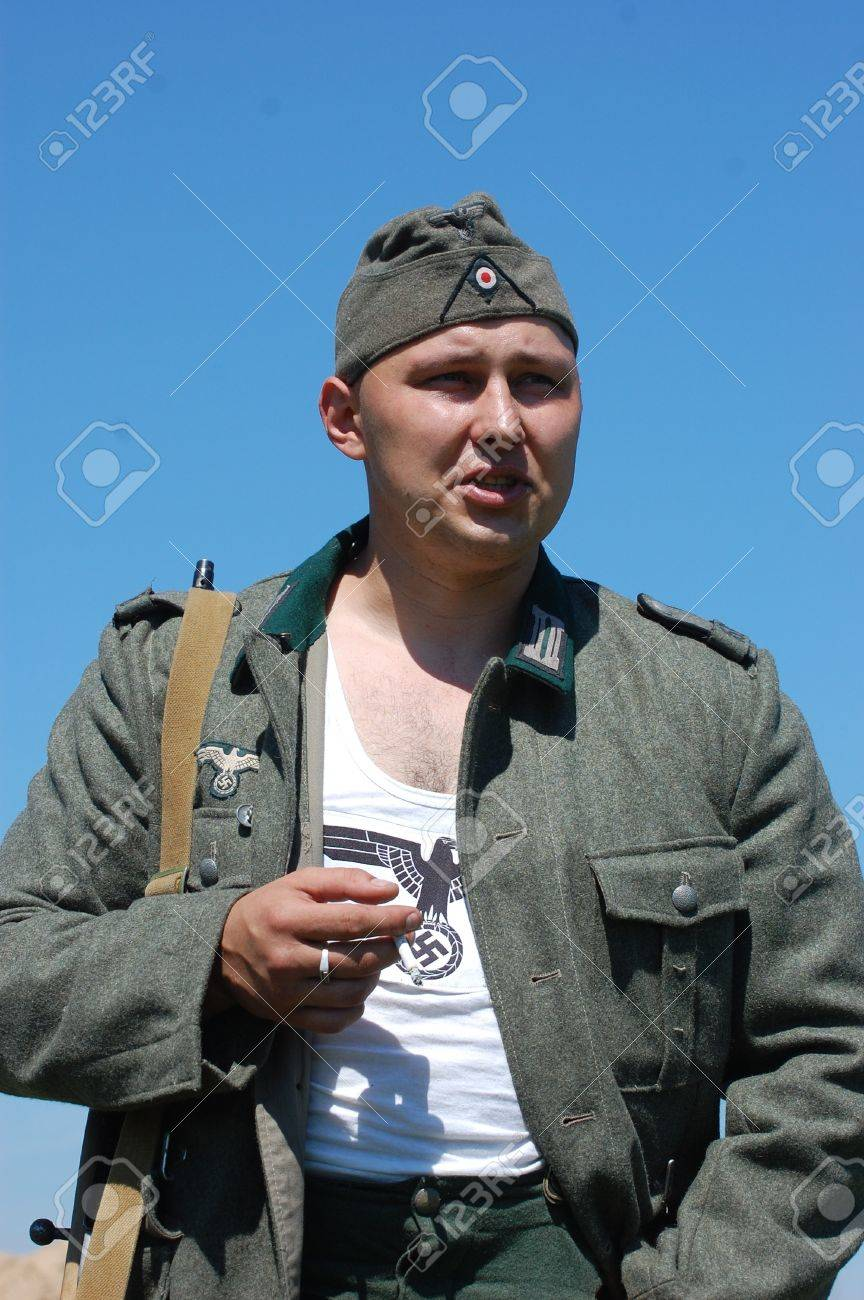 KIEV, UKRAINE -MAY 11: Member of Red Star history club wears historical German uniform during historical reenactment of WWII, may 11, 2012 in Kiev, Ukraine  Stock Photo - 13627016