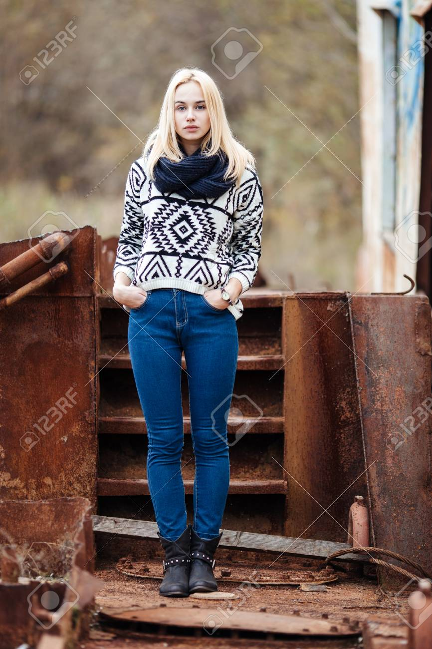 0f5970baa1 Stock Photo - Young adorable blond hipster woman in scarf