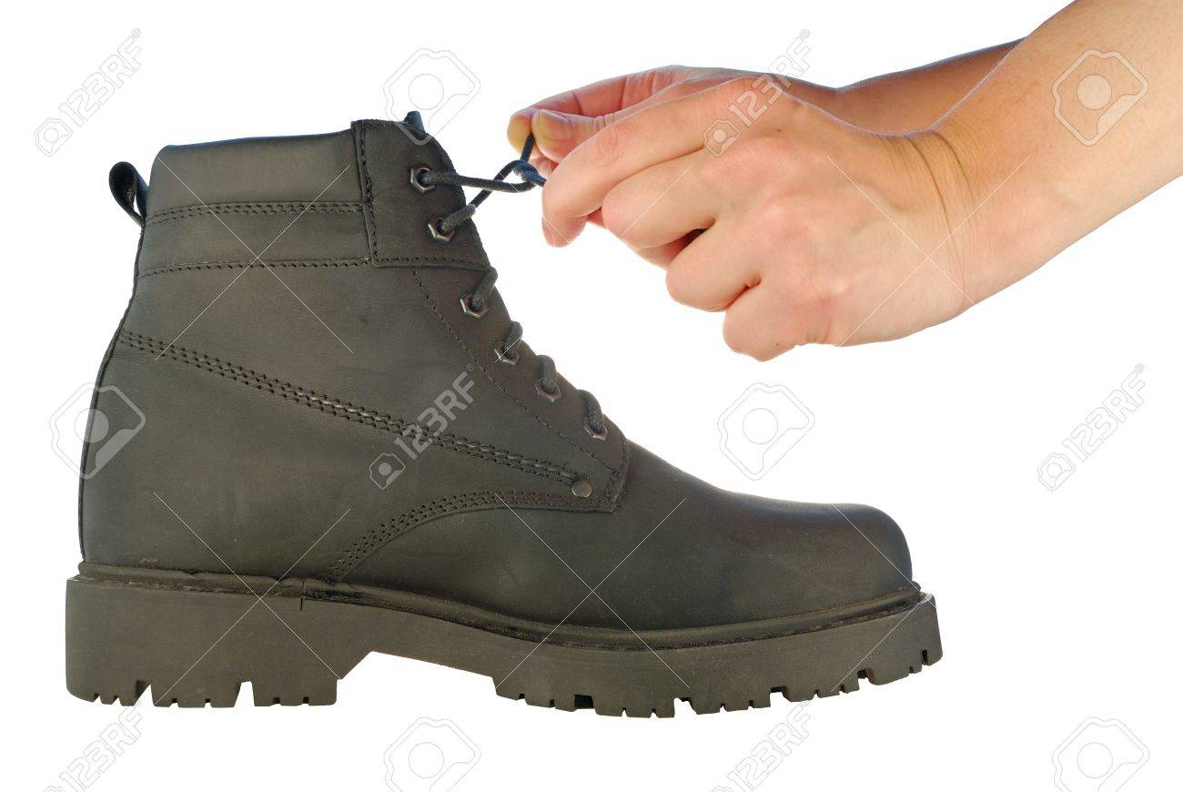 outlet boutique top design autumn shoes Hands Are Tie Shoe-laces On A Rough Boot On A High Thick Sole ...