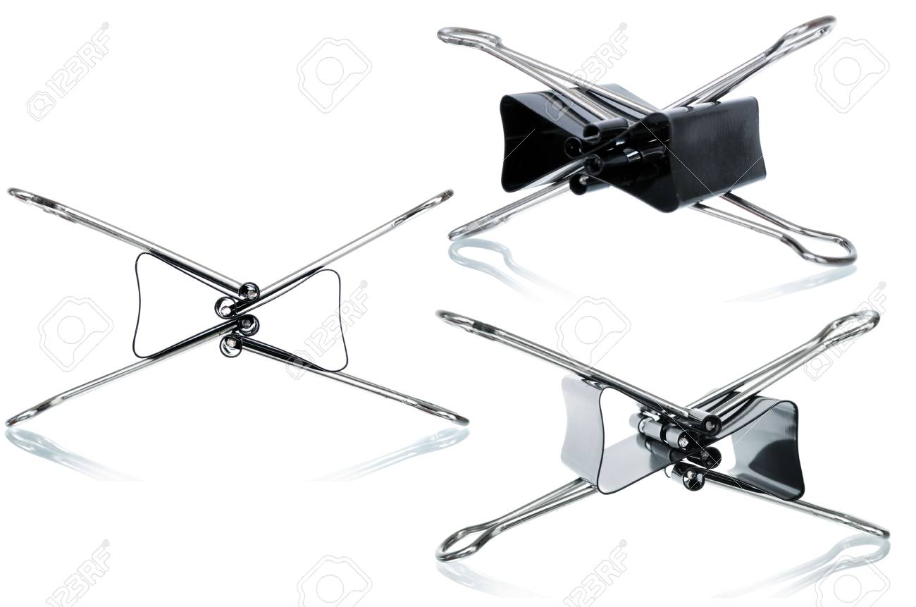 some black binder clips on white background Stock Photo - 5773308
