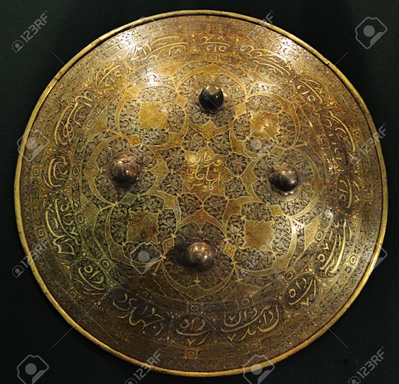 http://previews.123rf.com/images/sergieiev/sergieiev1110/sergieiev111000134/10923112-Medieval-eastern-shield-of-brass-Collection-of-National-Museum--Stock-Photo.jpg